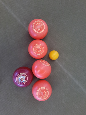 lawn bowling bowls in a row near jack